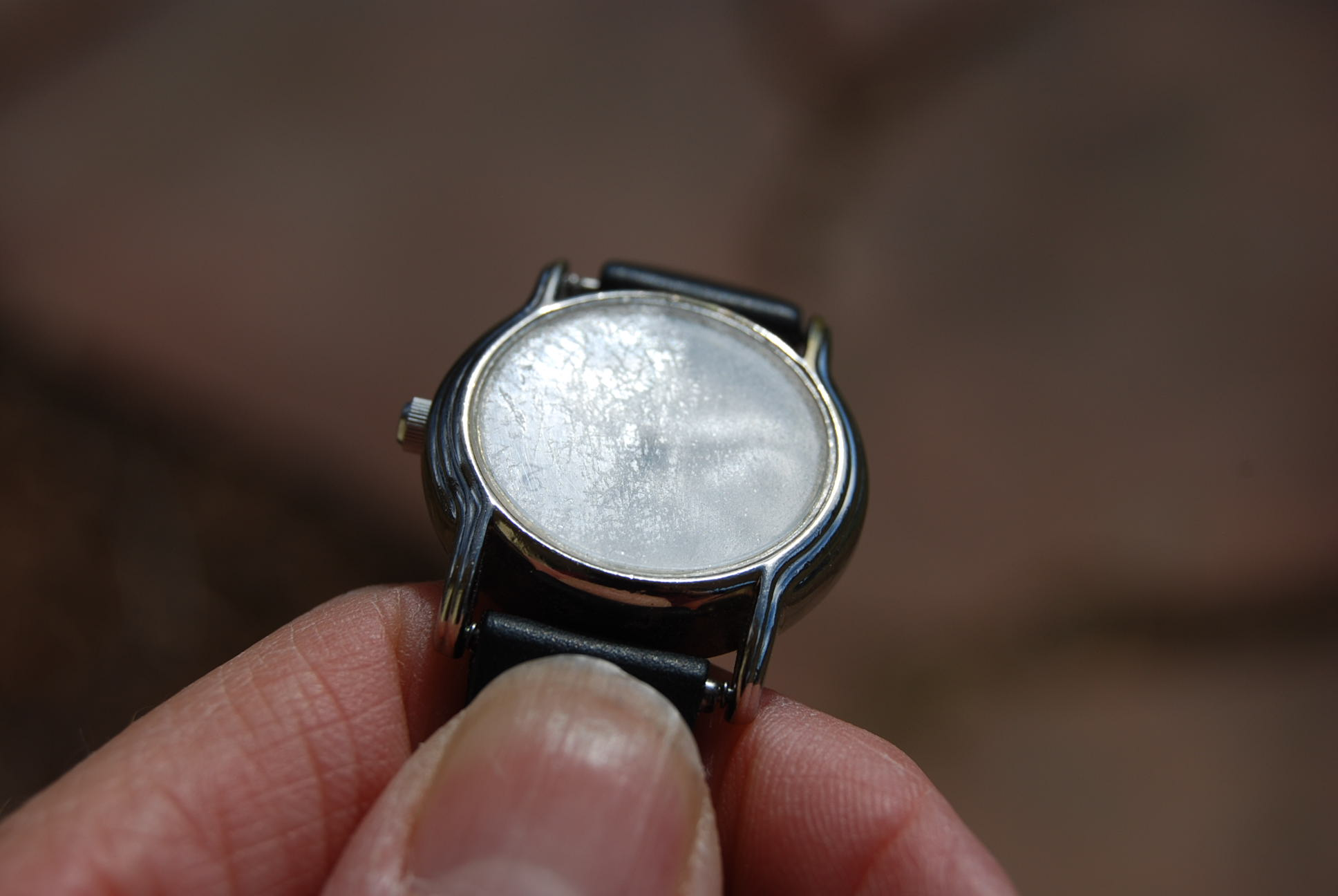 Vintage Watch Before restoring etched glass with cerium oxide